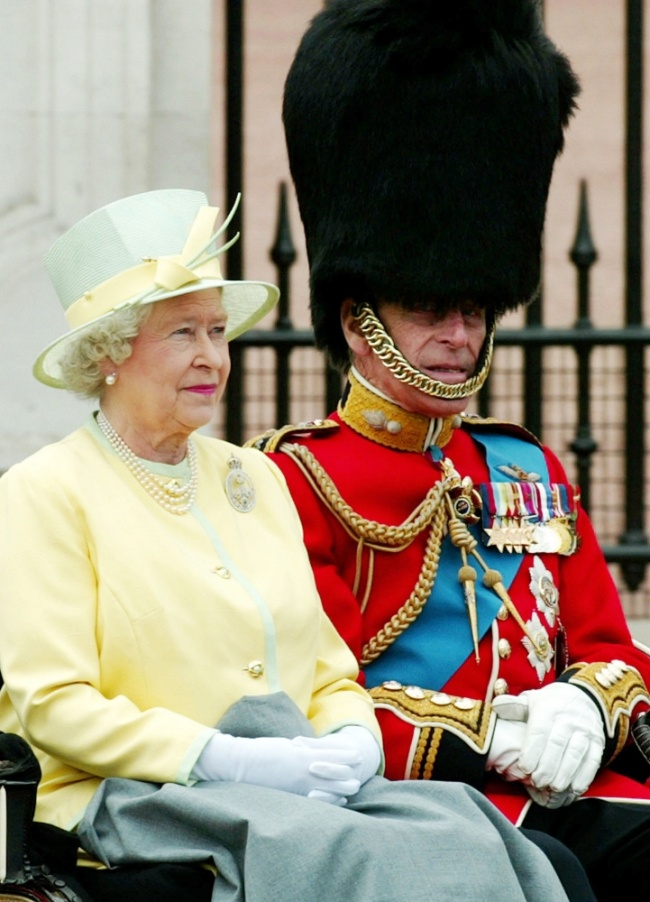 Queen Elizabeth and Prince Philip leave Buckingham Palace (Picture: AP)