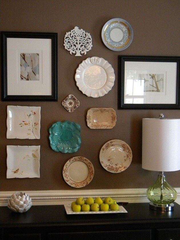 Plate wall decoration of different shapes and styles on brown dining room wall