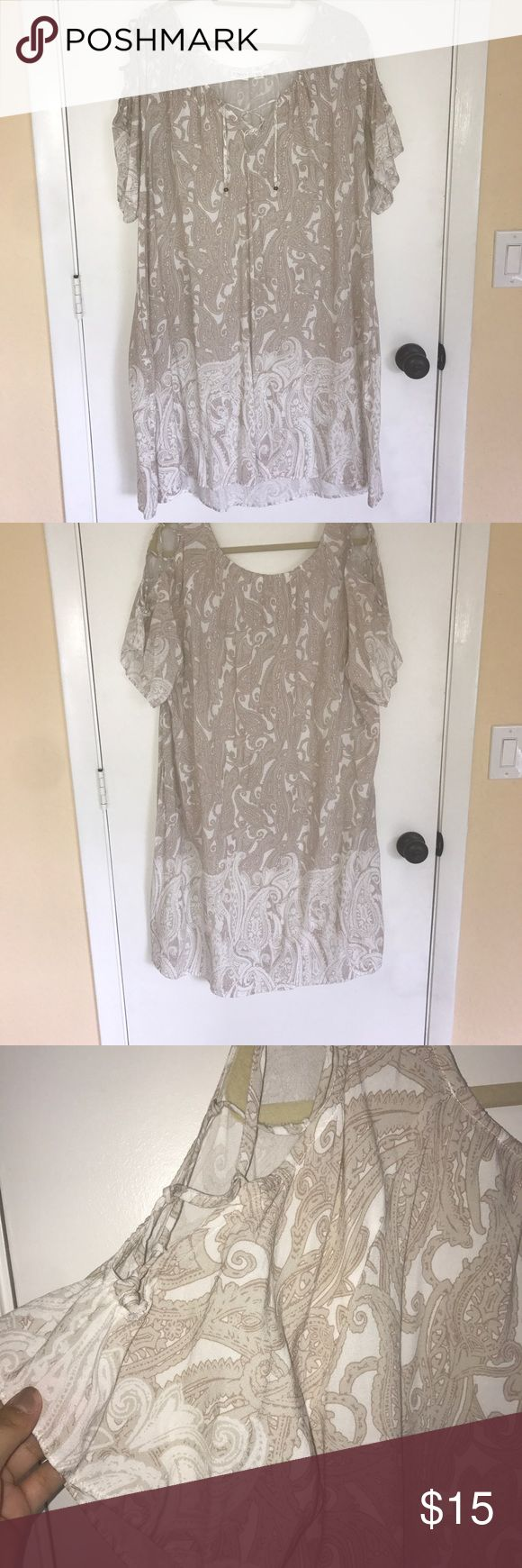 Paisley pattern weekend dress This is an easy throw on in the summer getting ready for the beach or pool, Or a hot summer weekend BBQ kind of dress. Has a subtle paisley print of tan and white, has nice cross cross accent detail on the sleeves and in the front of the dress. Cato Dresses