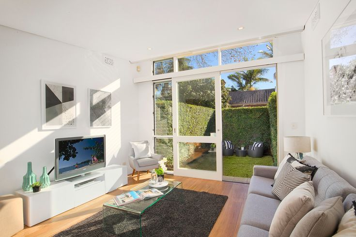 living, indoor-outdoor flow, sunny, lounge, wall art, rug, coffee table, pretty terrace, immaculate interiors, 20 Ferris Street, Annandale, Pilcher Residential