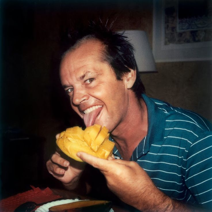 Jack Nicholson eating mango , ca. 1970s