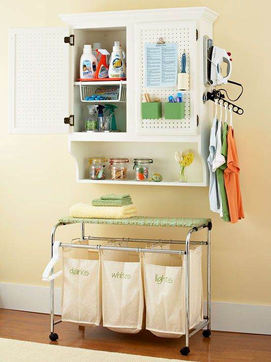 Make wash day less of a chore with a well-stocked, space-saving cabinet. Start with any plain cabinet, from a salvaged buffet top to a new kitchen cupboard, and mount it securely to the wall by anchoring it to wall studs. Then expand its function by replacing door panels with pegboard, securing an iron holder and hanger holder to the side, and adding a wall shelf if needed. Inside, a lazy Susan keeps spray bottles at the ready, a plastic tray catches drips from detergents, and a...