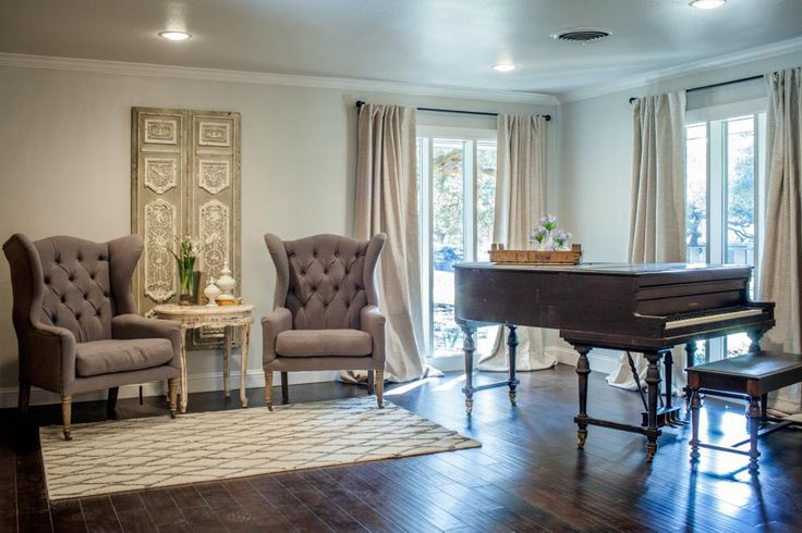 The new sitting room has an elegant feel with its birch hardwood floors, baby grand piano and a pair of upholstered wingback chairs.