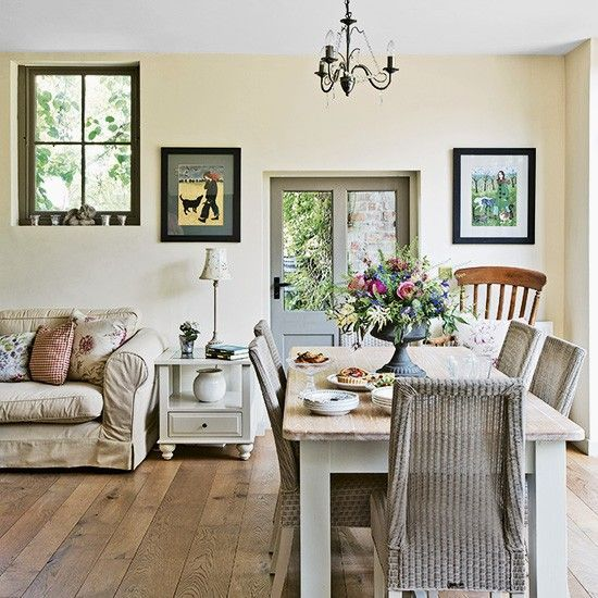 Open-plan dining area with glass doors beyond the table leading to the garden. A fan of neutrals, the owner has used them throughout, adding colour with accessories. Painted furniture is used to great effect, along with vintage finds, while painted floorboards give the kitchen a shabby chic feel. The downstairs is perfect for entertaining. 'There's space when everyone is home, and I love living in a market town because we have lots of friends who pop by.'