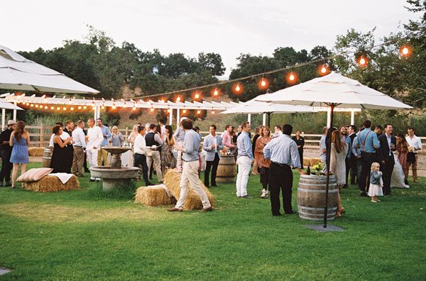 Romantic Bohemian Ojai Wedding... I want something similar with the umbrellas!! @Erin Shoemaker