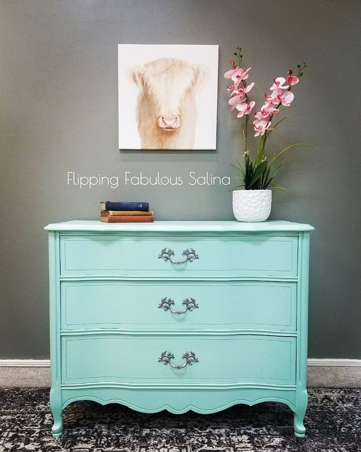 This Basset French Provincial was plucked from our inventory for a little girls room! Painted in Fusion Mineral Paint Laurentien with Ultra Grip on the top, it's the perfect minty turquoise, I added a nice shimmer with Fusion Pearl Wax. #flippingfabuloussalina #laurentein #fusionmineralpaint #paintedfurniture #frenchprovencial #bassett #teal #mint #turquoise #dresser #ultragrip #pearlwax #blue #nursery