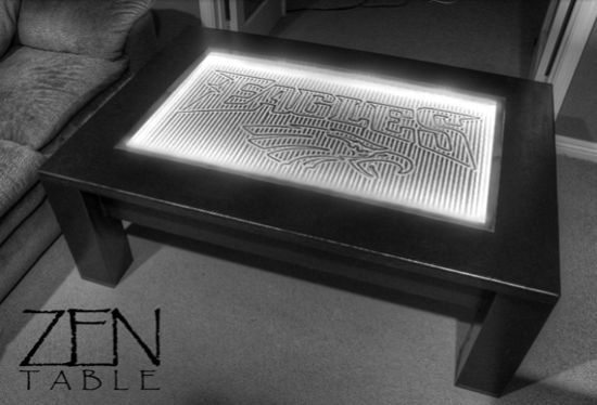 Upload images to your 3G Zen coffee table and it will draw it onto the sand-like material under the glass.