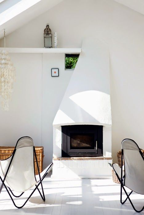 White + fresh outdoor lounge area | White butterfly chairs, outdoor fireplace, bohemian light