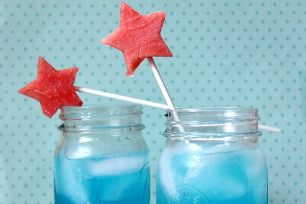 A Festive All-American Lemonade    This blue lemonade recipe comes with a watermelon star embellishment making it the signature cocktail for all of your patriotic summer celebrations this year. Mix up this grown up lemonade with a little booze for the adults or keep it kid-friendly without it.    Read more: http://www.celebrations.com/content/sizzling-summer-cocktail-ideas#ixzz2UpK3aU00