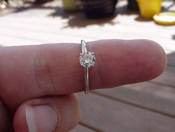 totally the perfect ring. $275.00 0.38CT solitaire engagement ring. not much but simple and really pretty