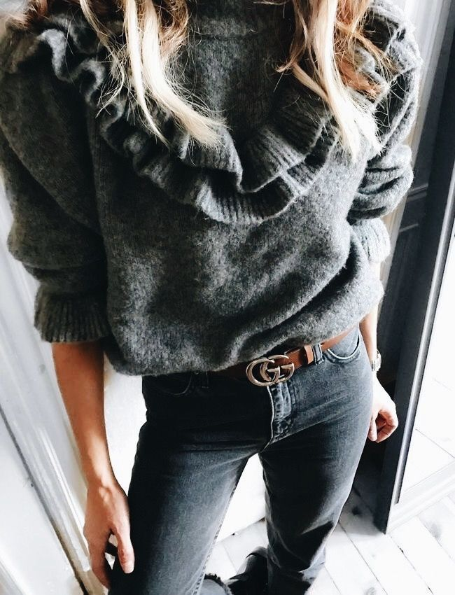 Cute gray ruffled knit sweater.