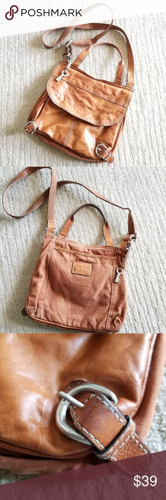 """Fossil Bag / Purse Leather / Fabric Fossil Bag / Purse / Crossbody / shoulderbag. Hippy, boho style. One side is brown leather the other side is fabric. Good condition but the leather side has a few pen marks and the fabric side has a faded spot as shown. No holes or tears. The inside is pretty clean. Silver hardware, measures about 12"""" x 10"""" x 3"""". Hippy purse, boho purse. Shoulder bag Fossil Bags Crossbody Bags"""