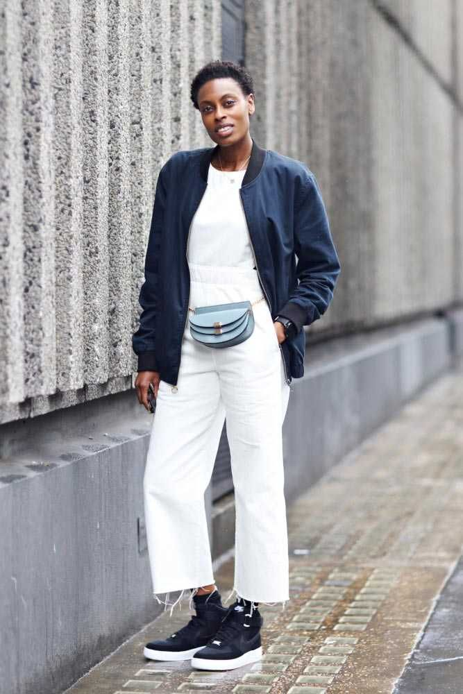 Donna Wallace, Accessories Editor River Island bomber jacket, ASOS white jumpsuit, Office trainers, Chloe bum bag. What ELLE Wears, LFW SS 2016 Street Style.