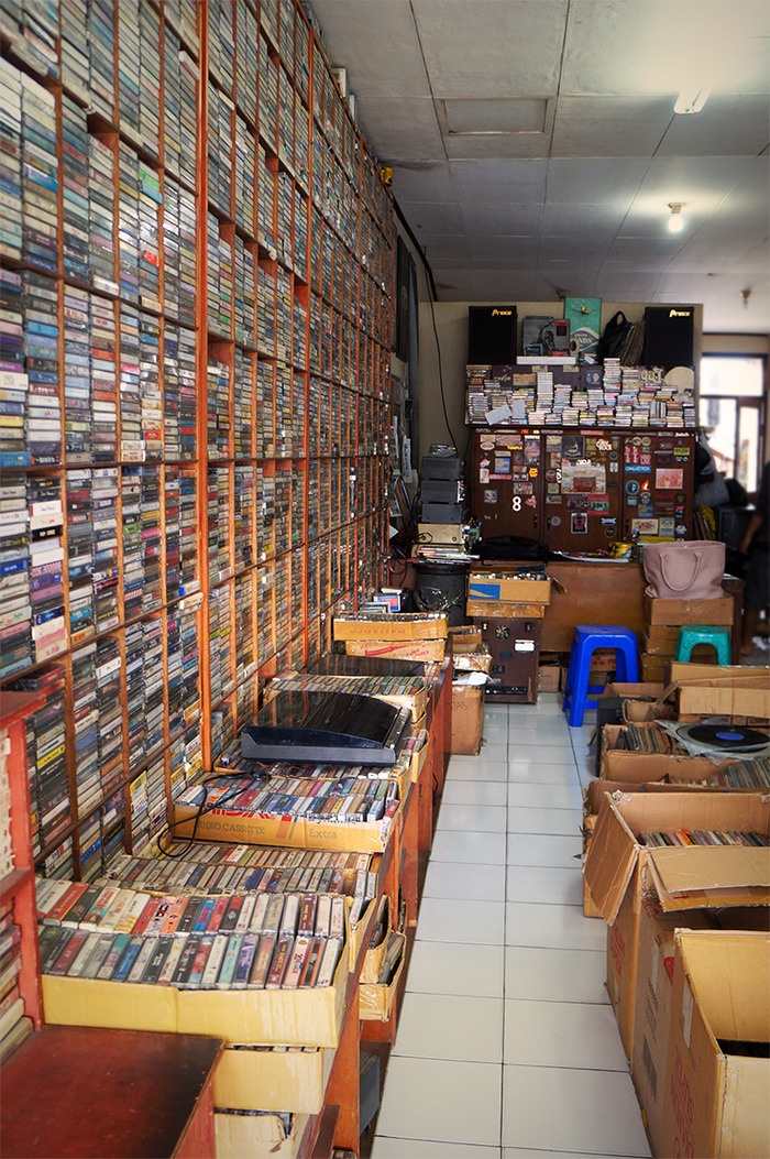 The racks of the store are crammed with cassettes and the sheer mess makes getting around a little tricky. But music gee...
