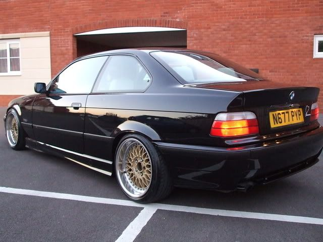 Black BMW e36 coupe on very whell fitted OEM BMW Styling 5 (BBS RC) wheels