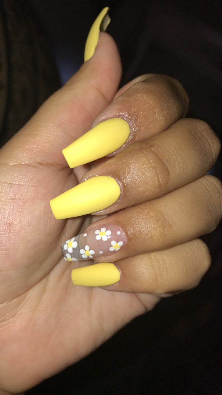 yellow nails with sunflower design