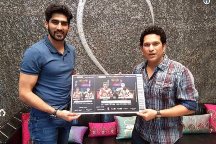 "The first ticket of the fight night was presented to the cricket legend Sachin Tendulkar by the Indian boxing sensation Vijender Singh at his residence in Mumbai. Vijender posted a picture with Sachin on Twitter, captioned, ""The very first ticket of my fight was presented to @sachin_rt .   #000 #a double title fight #August 5 in Mumbai #cricket legend Sachin Tendulkar #first ticket of the fight #India's flag #Indian boxing sensation #Mumbai #Rs. 12 #Rs. 1200/ #sachin tendul"