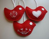 Scandanavian Felt Ornaments. $20.00, via Etsy. Adorable!! Gotta get some for present toppers...