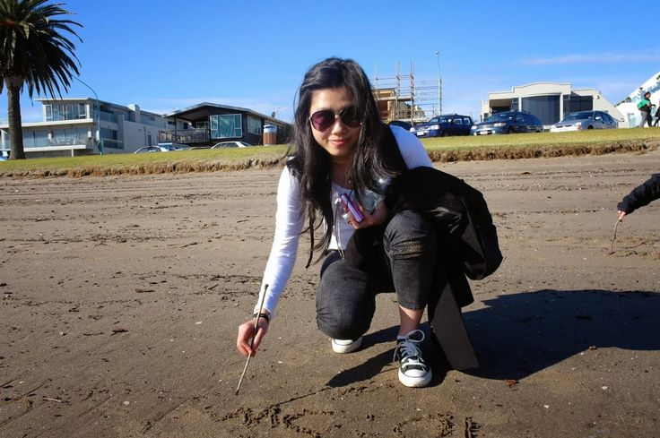 me writing a few words on the sand - cheesy :-)