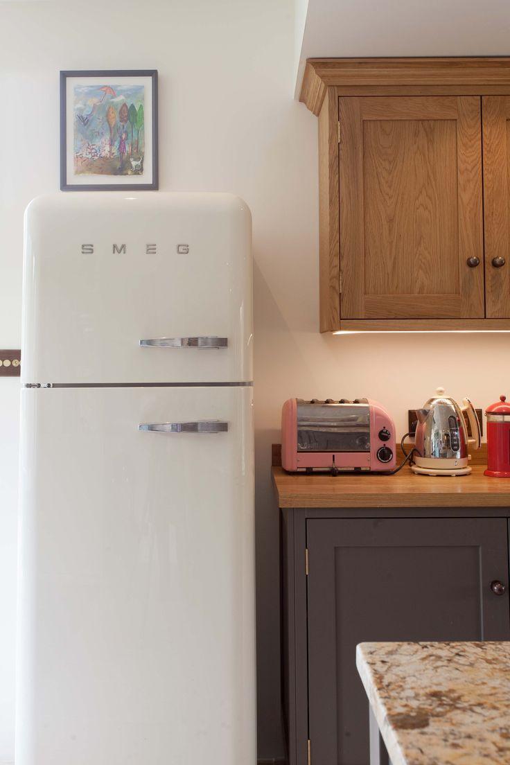 Quirky kitchen design with Smeg fridge.