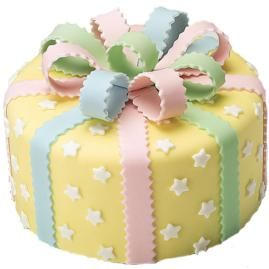 Take a Bow Cake ~ It's fun to match the cake to the celebration! This cake can be decorated in any color scheme. With a pretty bow on top, this cake is all wrapped up and ready to party in easy-to-use fondant