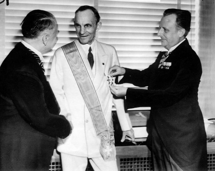 Henry Ford receiving the Grand Cross of the German Eagle from Nazi officials. 1938.