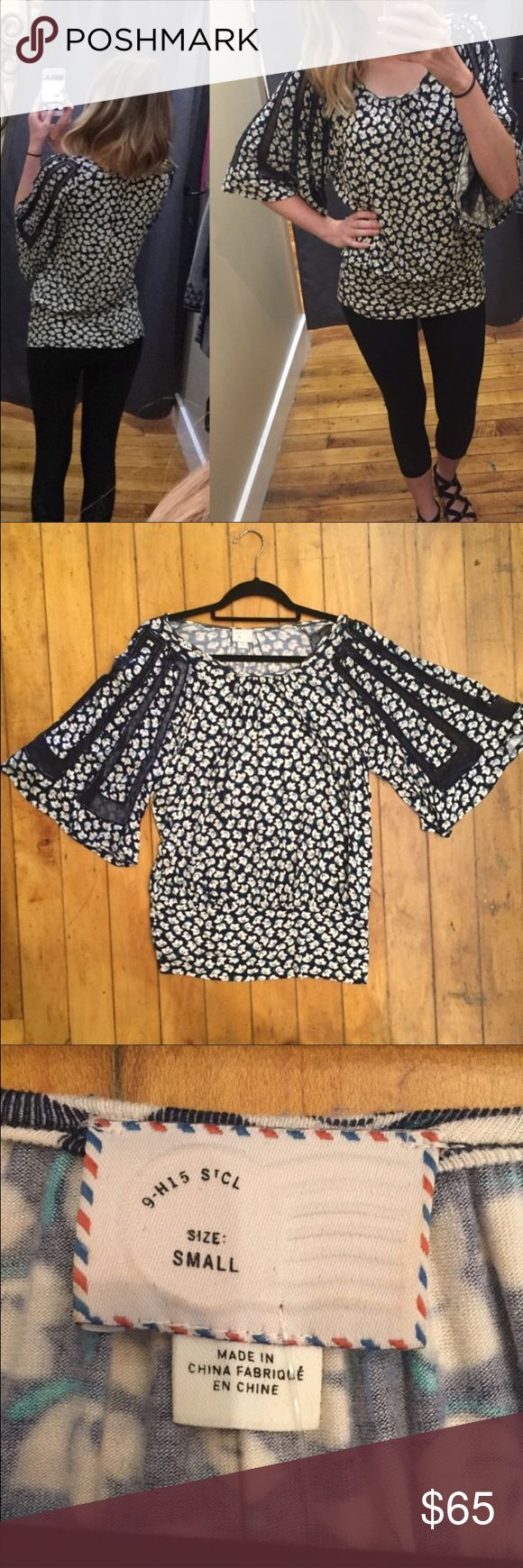 Anthropologie brand blue floral tunic size small ⚜️I love receiving offers through the offer button!⚜️ Great condition, as seen in pictures! Fast same or next day shipping!📨 Open to offers but I don't negotiate in the comments so please use the offer button😊 dimensions: sleeve length- 17 inches, length from the top of the shoulder to the very end of this tunic is 27 inches Anthropologie Tops