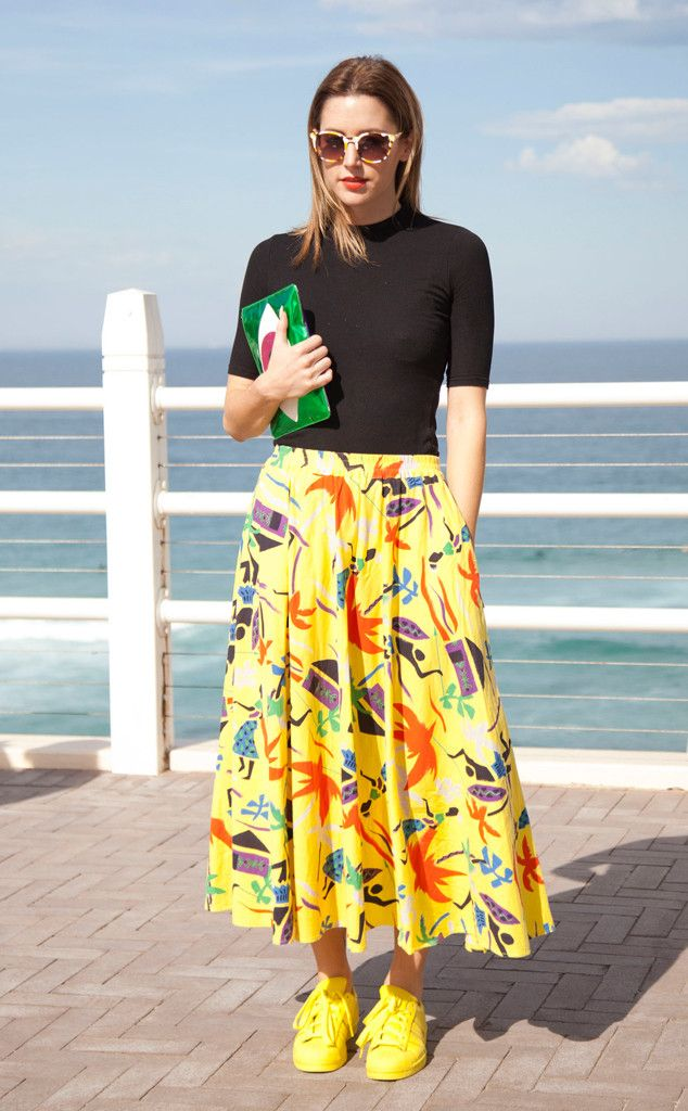 Poppy Lissiman from Street Style: Midi Skirts  Wears her own design bag and sunglasses, Topshop shirt, vintage skirt and Adidas sneakers