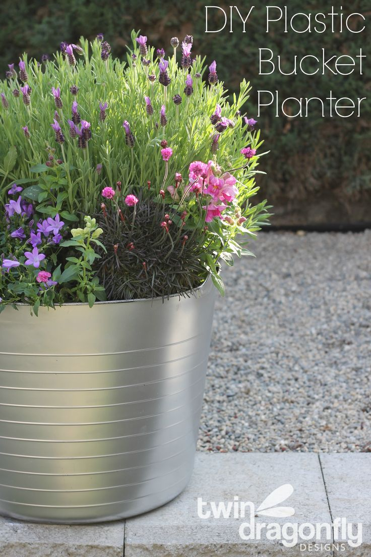 Create a faux galvanized planter with a plastic bucket and spray paint!