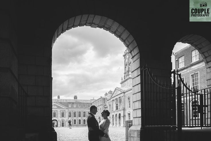 under the arch in Dublin Castle. Real Wedding by Couple Photography