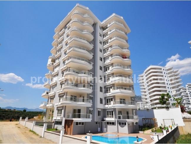 Продаются новые апартаменты класса люкс в центре Махмутлара в Аланье! Недвижимость в турции