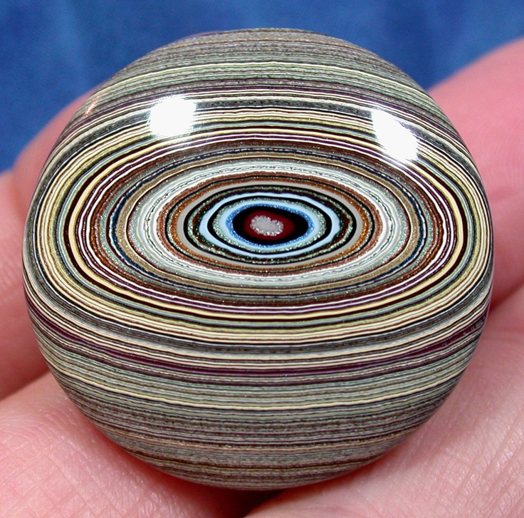 Solid Detroit Agate / Fordite Cabochon  Early 1960's Material  (suzybones). via Etsy. Not an agate at all - the original material was created many years ago at the Ford Rouge Plant just outside of Detroit, Michigan. Layer upon layer, paint over-spray built up on metal racks that transported new car bodies through the paint shop, and into the oven, where each coat was baked hard.