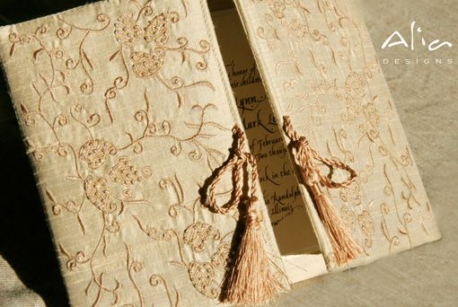 AliaDesigns.com are the first to introduce fashion forward invitations with delicate details and elegant designs. They create custom three dimensional invitations made of exotic materials from around the world that go way beyond paper.