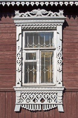 Carved window in old Russian wooden country house by  Victor Sagaydashin