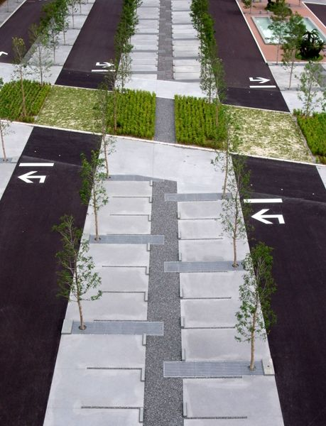 Interesting car park design giving space to green and people.
