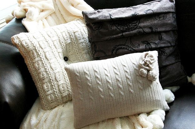 A lot of cute sweater repurposing ideas but these sweater pillows are so much!