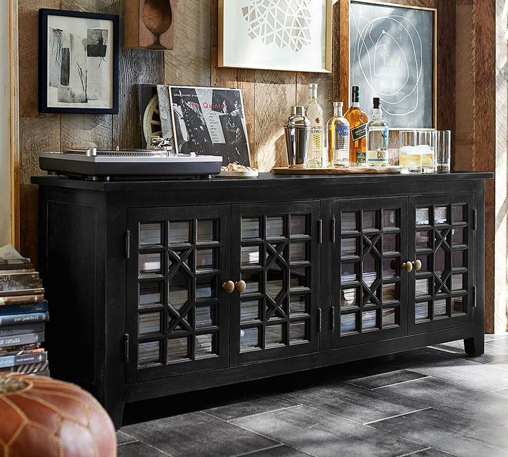 Reimagine your furniture! A console can be used in an entry, media room as as a bar - don't limit yourself to what the piece was intended for originally.