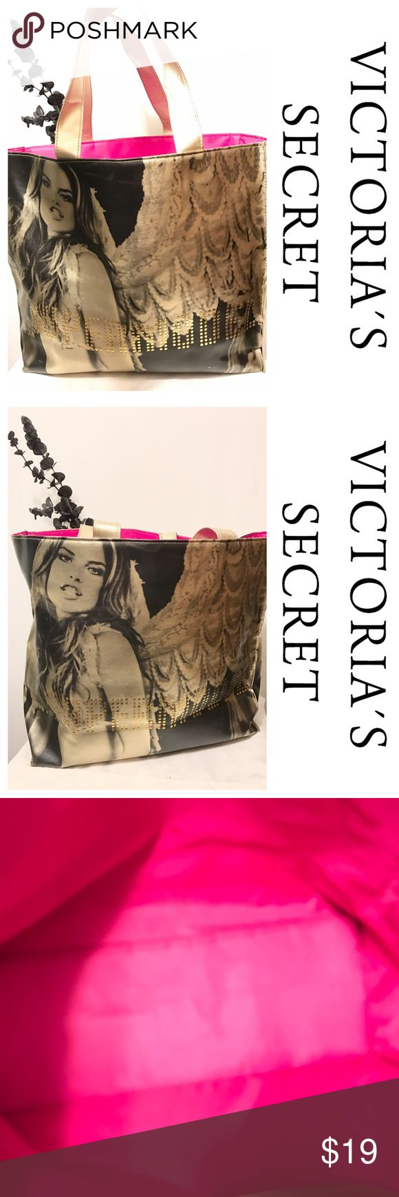 Victoria's Secret Tote Large vinyl Victoria's Secret Tote with Victoria's Secret model with wings.  Supermodel spelled out in gold accent.  Pink cloth interior.  Tote has a manufacturing flaw on one side and slight wear in bottom.  Interior has a couple small stains but camera can not pick them up. Victoria's Secret Bags Totes