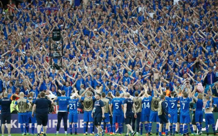 Iceland football team celebrate with their fans at Euro 2016
