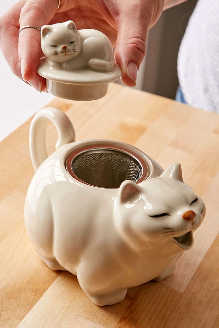 Big Cat Tea Pot .. in shape of white cat with curled tail as handle, open mouth as spout, small kitten on its back forming the lid, ceramic with stainless steel infuser basket