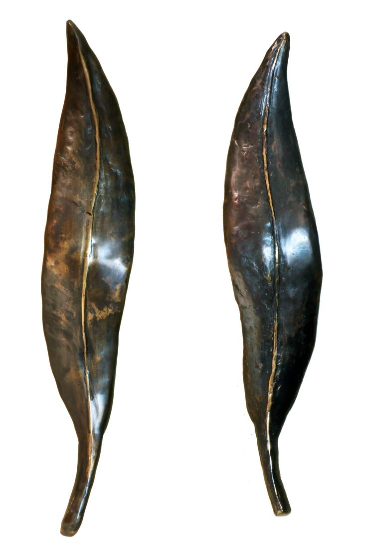 Bronze sculptural door furniture by Ivana Perkins, noted Australian artist. Ivana has created a range of hardware that expresses the moods of the Australian nature.  Pair of Leaves - Pulls & Knobs #motherofpearl #hardware #MOP #knobs #homdeco #renovation #indian