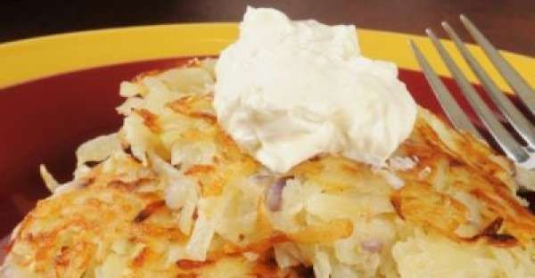 Potato Latkes Topped With Sour Cream Recipe.  This Potato Latkes Topped With Sour Cream Recipe is a delicious potato recipe full of potato nutritional benefits and potato nutrients. Potatoes are a recipe that works in all sorts of potatoes recipes from scalloped potatoes recipes, mashed potatoes recipes, roasted potatoes recipes, baked potatoes recipes and more.   CLICK VISIT for FULL RECIPE!