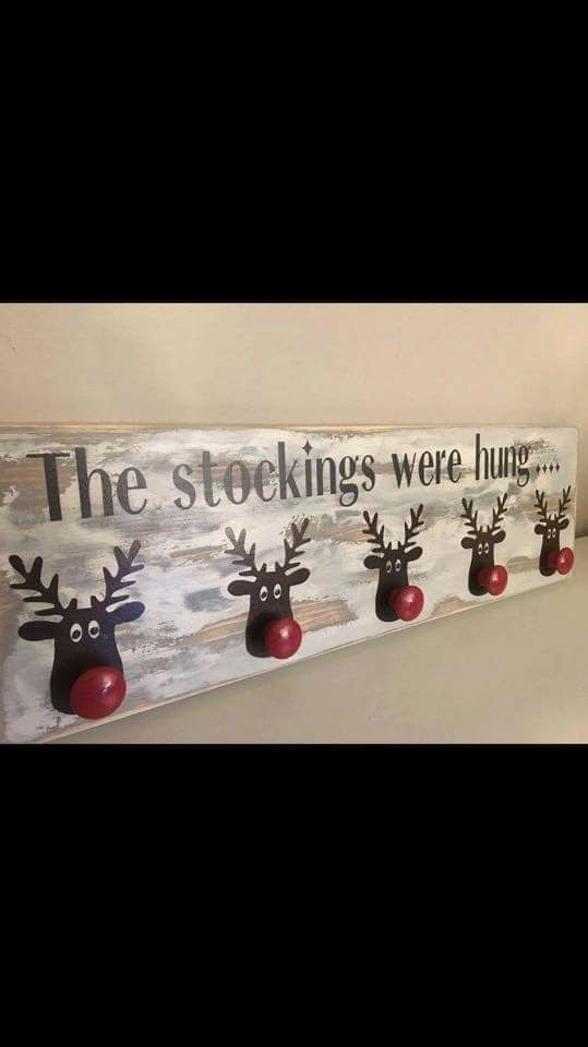 The stockings were hung... Wall stocking hanger made with a painted & stenciled board with reindeer with red knobs for their noses. Adorable!