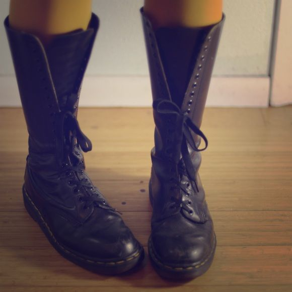 Knew high black leather Dr. Martin boots This is a pair of black leather Doc Martin Boots. Tall and strong, will last a long time as Doc's are known for. Has some use, scuffs on toes as with most boots. Super comfortable, well loved. Not suggested for wide calf. Dr. Martens Shoes Lace Up Boots
