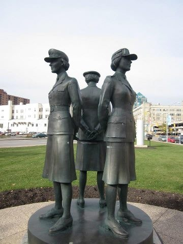 There is a statue on Winnipeg's Memorial Boulevard that pays tribute to the women who served in Canada's Armed Forces during WWI and II. During WWI nearly 3000 Canadian women were military nurses and during WWII some 45,000 women were clerks, cooks, heavy equipment drivers, telephone operators, parachute riggers and mechanics in Canada's armed forces.There are 3 figures in the statue and they represent each branch of the armed forces, the army, the navy and the airforce ~