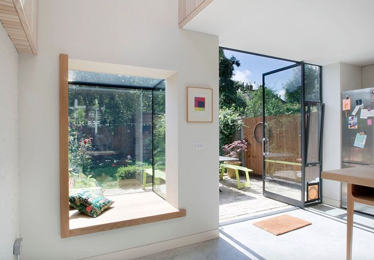 Window Seats and pivot door with extra openable window slot