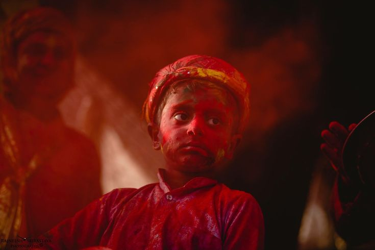 The young boy was curiously watching the festival of colors in the temple of Nandgaon which also the birth place of Lord Krishna.