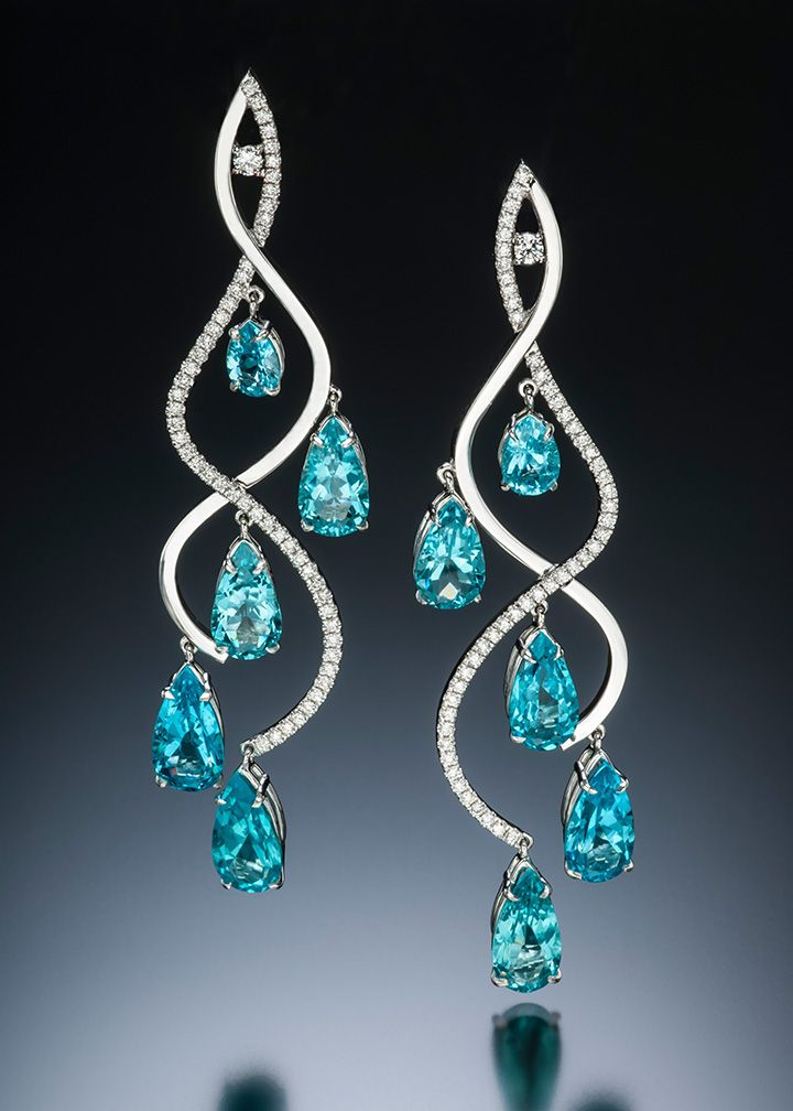 Graceful and dazzling. Stilla earrings feature rare apatite from Madagascar with diamonds set in curves of 14 karat white gold. Adam Neeley Fine Art Jewelry