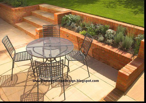 mini garden next to retaining wall