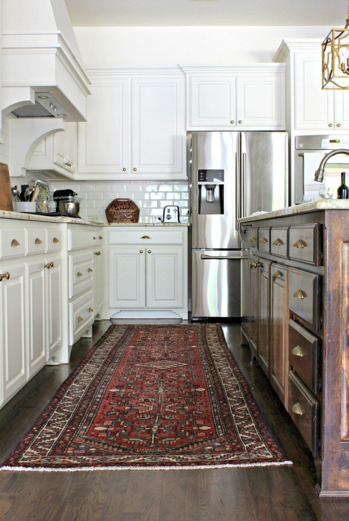 Hand knotted wool runner in a white kitchen with brass hardware, kitchen makeover from Sharon Joyce Interiors